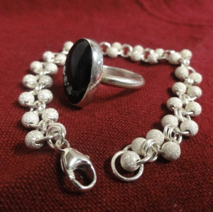 Claire Carson's bracelet and ring