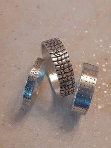 Embossed silver rings